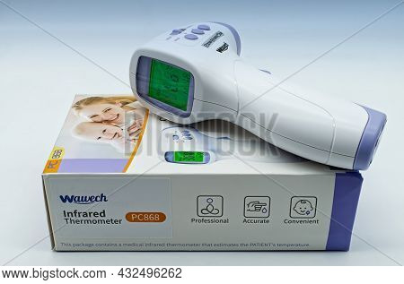 Bologna - Italy - May 12, 2021: Wawech Infrared Thermometer Isolated On White Background.
