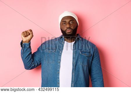 Serious And Confident African-american Male Activist, Raising Fist, Support Black Lives Matter Blm M