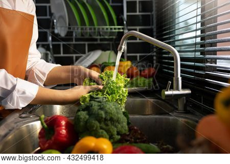 Asian Hands Woman Washing Vegetables Salad And Preparation Healthy Food In Kitchen.