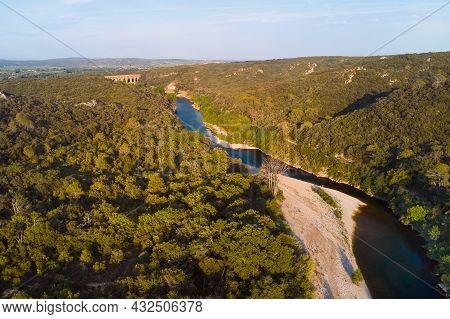 Drone Image Of River And Landscape At Pont-du-gard Site In Provence In France