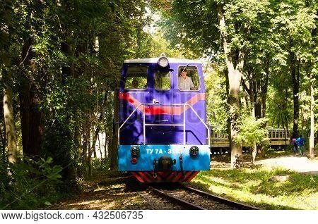 Kyiv, Ukraine-august 22, 2021:close-up View Of Locomotive Tu7a. Children's Train On The Curve Track