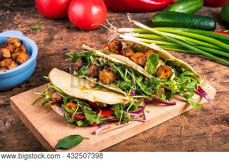 Vegetarian Tacos - Tortillas With Vegetable Salad And Fried Tofu On A Wooden Board On A Table With I