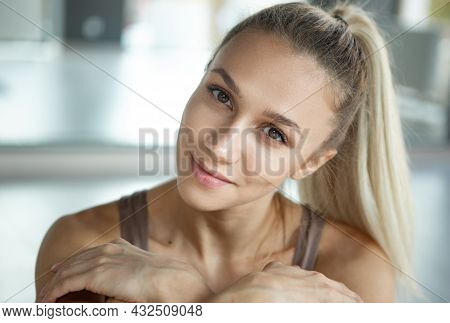 Close-up Shot Of Smiling Young Girl With Long Hair Sitting At Yoga Meditation Center. Concept Of Hea
