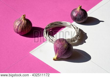 Autumn Colors. Purple Fig Fruits On Vibrant Fuchsia And White Geometric Layered Paper.natural Wattle