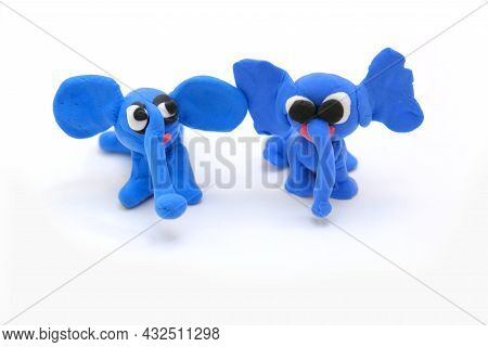 Home Education Game With Clay. Child Made Funny Elephants  From Colorful Plasticine, Early Developme