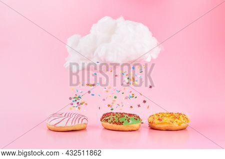 Colored Sprinkles Fall From Cloud. Assorted Donuts Frosted, Pink Glazed And Sprinkles On Pink Backgr