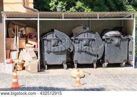 Cardboard Is Bundled Into Bales. Dustbins Being Full With Garbage. Garbage Is Pile Lots Dump. Garbag