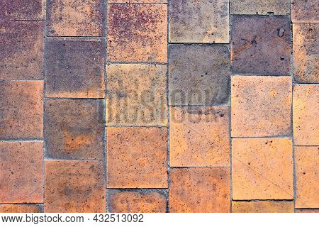 Orange Brown Purple Old Shabby Worn Out Floor Tiles With Damages Cracks Dirt Caverns Potholes And Pa