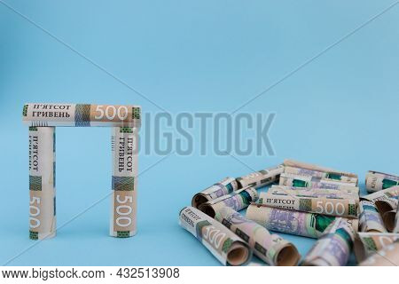 Construction From Rolled Ukrainian 500 Banknotes. Money Constructor.