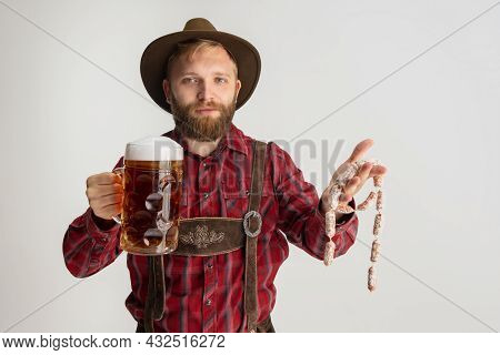 Comic Portrait Of Bearded Man In Hat And Traditional Bavarian Costume Holding Huge Mug, Glass Of Lig