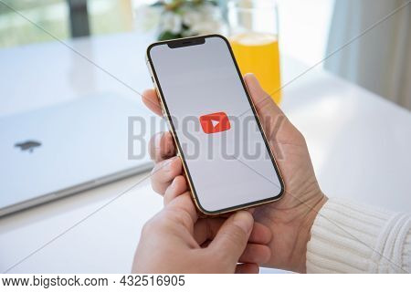 Alanya, Turkey - March 30, 2021: Man Hand Holding Apple Iphone 12 Pro Max Gold With App Youtube Prov