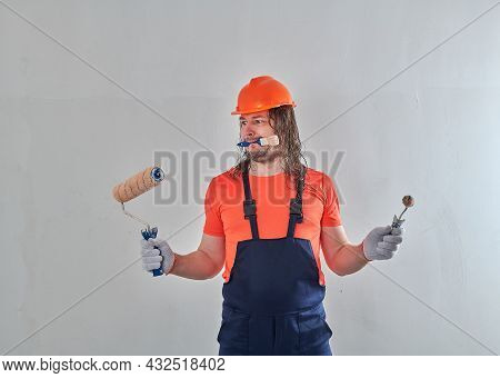 Funny Repairman With Paint Rollers And A Paintbrush Stands