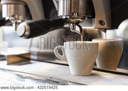 Close Up Machine Pouring Coffee Cup. High Quality Beautiful Photo Concept