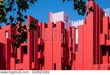Calpe, Spain - 19 July 2021: Facade Of The Postmodern Apartment Building 'la Muralla Roja', The Red