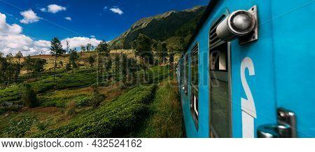 Blue Train In Sri Lanka. Blue Sri Lankan Train Goes Through Jungles, Trees, Wood, Mountains. Travel