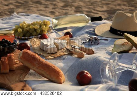 Different Tasty Snacks On Picnic Blanket Outdoors