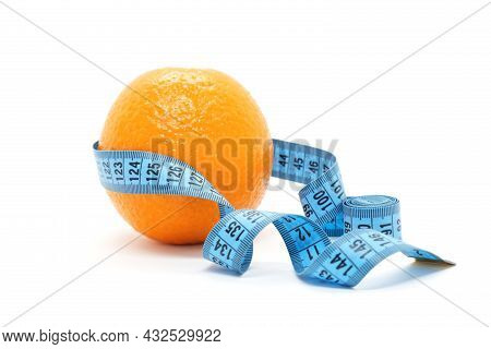 Fruit Orange Is Wrapped With Blue Measuring Tape On White Background. Orange Peel As A Symbol Of Cel