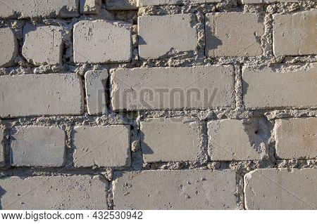 Painted In Grey White Colors Old Vintage Empty Brick Wall Background With Copy Space. Rustic Cemente