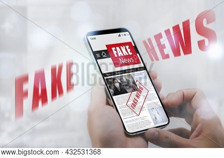 Fake News Online On Smartphone Concept, Businessman Reading Fake News Or Articles About Covid-19 In
