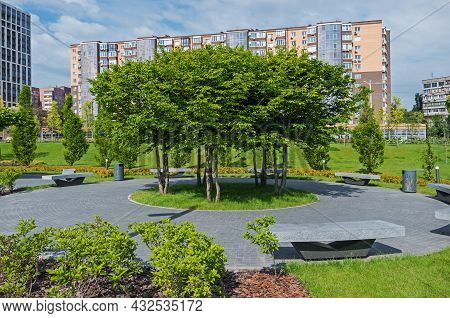 Beautiful Place To Relax In The Courtyard Garden Of Multi-storey Residential Complex On Sunny Spring