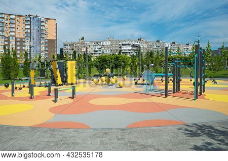Survey View Of Colorful Large Playground In City Park. Empty Modern Outdoor Playground In The Middle