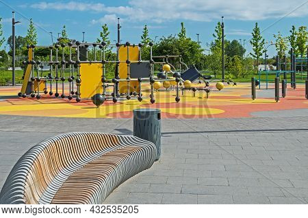 Modern And Colorful Large Playground In City Park. Empty Modern Outdoor Playground In Springtime. Be