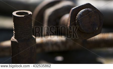 Old Rusty Bolt, Iron Rod With Screw Threads. Rusted Mechanical Components. Threaded Bolt And Nut. Di