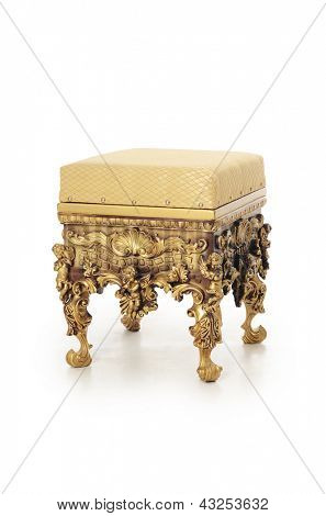 Ancient stool in a gold ornament isolated
