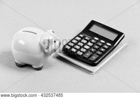 Moneybox With Calculator. Piggy Bank. Planning Counting Budget. Commerece Business. Bookkeeping. Fin
