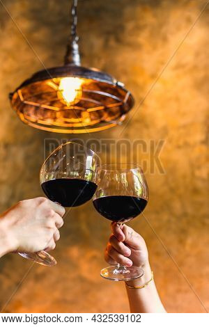 Celebration Concept Couple Clinking Glasses Of Red Wine.