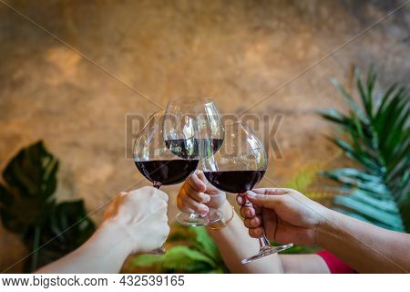 Party And Celebration Concept, Friends Clinking Glasses Of Red Wine.