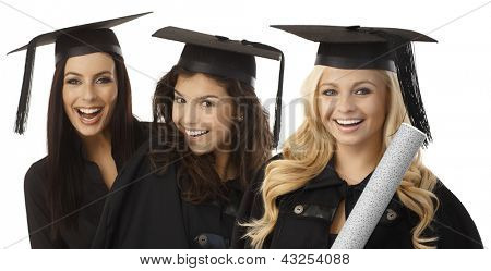 Closeup portrait of beautiful young female graduates in square academic cap smiling happy holding diploma.
