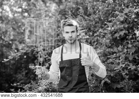 Man Hold Grilling Grid. Grilling Food. Backyard Barbeque Party. Handsome Guy Cooking Food. Picnic Co