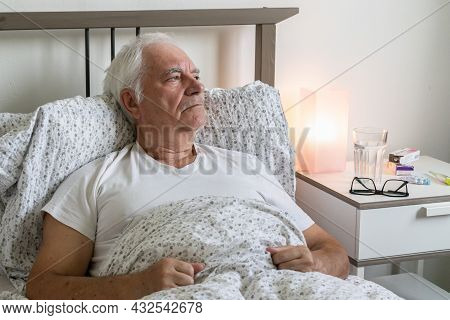 Aging Senior Man Male In Bed At Home Flat Tired Sick Ill Alone Retired Resting Virus Taking Care Unh