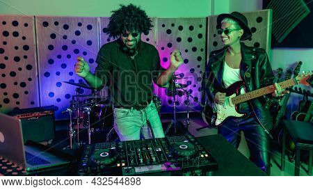 Young Happy People Playing Music With Dj Mixer And Guitar In House Production Studio - Youth Musicia