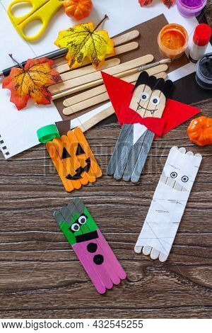 Halloween Ghost, Pumpkin, Mummy And Vampire Toy Gift Stics Puppets On Wooden Table. Handmade. Projec