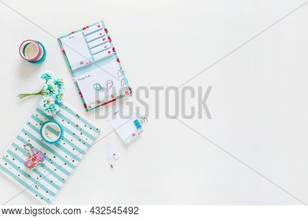 Open Notebook, Notebook With Colored Paper Clips, Clip, Tape On A White Background. Stationery And D