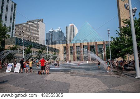 Edmonton, Alberta - July 30, 2021: People Playing In The Fountains In Front Of Edmonton City Hall.