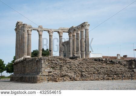 Beautiful View Of Fhe Ruins Of The Roman Temple At Evora, Portugal, Europe. Blue Sky.
