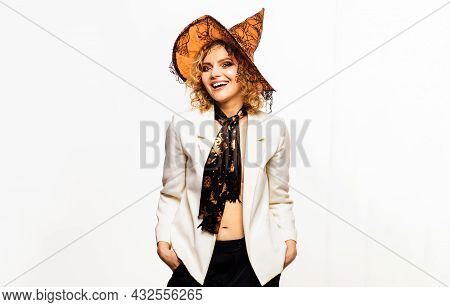 Happy Girl In Halloween Costume. Smiling Woman With Witches Hat. 31 October. Trick Or Treat. Hallowe
