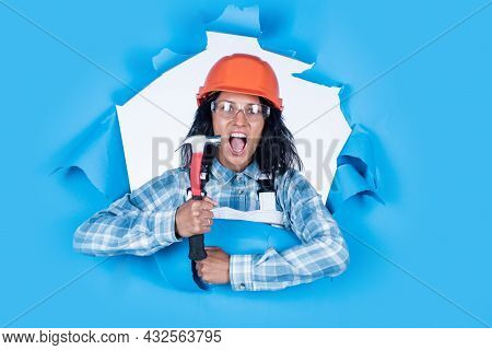 Repair And Renovation. Woman Wear Protective Glasses Helmet. Girl Builder In Hard Hat On Constructio