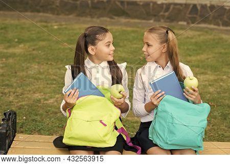 Beginning Their Knowledge Journey. Happy Girls Back To School On September 1. Little Children On Sep