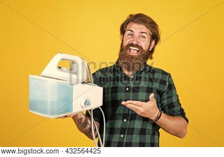 Presenting Product. Perfect Husband Duty. Bearded Male Housekeeper. Hipster Ironing Clothes. New Tec