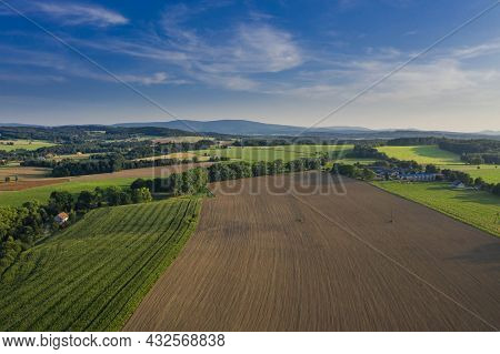Vast, Undulating Terrain Covered With Meadows And Arable Fields. In Some Places You Can See Single T