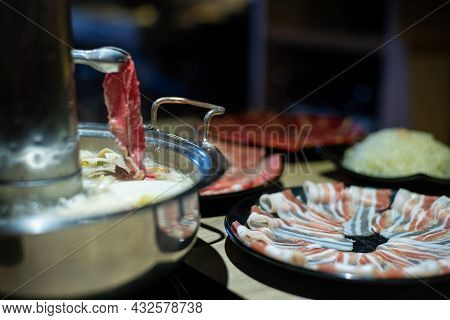 Traditional Chinese Hot Pot Style With A Donut-shaped Brass Pot. Hotpot At China
