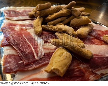 Slices Of Dried Pork Also Known As Jamon Serrano With Crusty Bread Toast Spanish