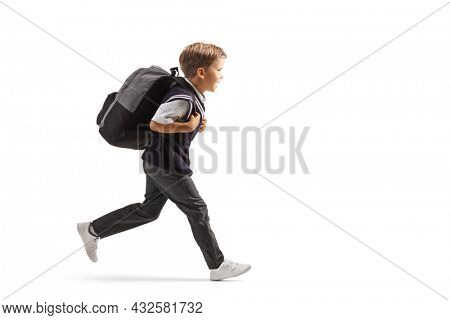 Full length profile shot of a schoolboy in a uniform running fast isolated on white background