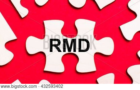 On A Bright Red Background, White Puzzles. In One Of The Pieces Of The Puzzle, The Text Rmd Required