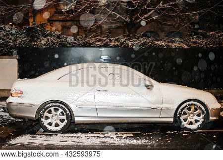 Strasbourg, France - Dec 3, 2017: Covered With Snow Car Luxury Mercedes-benz Silver Slk Coupe On The