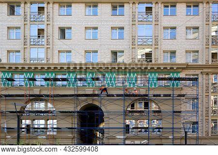 Saint Petersburg, Russia - July 09, 2021: Builders Perform Facade Work On A New Multi-storey Residen